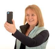 Woman taking photo with a mobile Royalty Free Stock Images