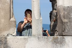 Woman taking photo with mobile stock photo