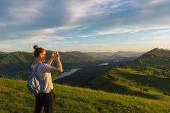Woman taking photo in mountain Stock Photo