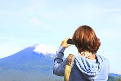 Woman taking photo of the mountains with smartphone. Tourist take photo with mobile Royalty Free Stock Photos