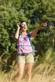 Woman taking photo in nature Royalty Free Stock Photo