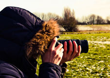 Woman taking photo from nature Stock Image