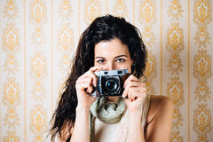 Woman taking photo with old camera Stock Photography