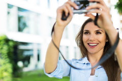 Woman taking photo outside Royalty Free Stock Photography