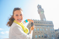 Woman taking photo of palazzo vecchio in florence Royalty Free Stock Photo