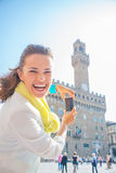 Woman taking photo of palazzo vecchio in florence Royalty Free Stock Photos