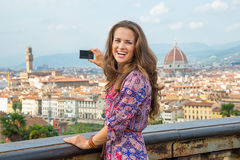 Woman taking photo of panoramic view of florence Stock Photo