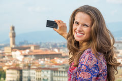 Woman taking photo of panoramic view of florence Royalty Free Stock Image