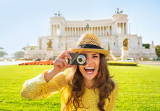 Woman taking photo on piazza venezia in Rome Stock Photo