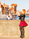 Woman taking photo picture with camera in old town Gdansk Stock Image