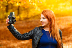 Woman taking photo picture with old camera outdoor Royalty Free Stock Images