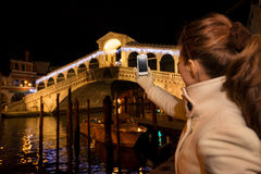 Woman taking photo of Rialto Bridge in Christmas Venice, Italy Royalty Free Stock Photo