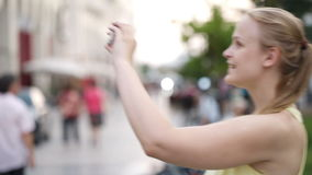 Woman taking a photo while sightseeing Royalty Free Stock Images