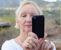 Woman taking photo with smart phone Royalty Free Stock Photos