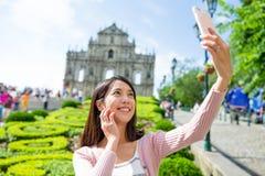 Woman taking photo by smart phone in Macau Stock Image