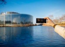Woman taking photo with smartphone of European PArliament Strasb Royalty Free Stock Photos