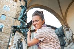 Woman taking photo of statue perseus in florence Stock Images