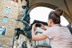 Woman taking photo of statue perseus in florence Stock Photography