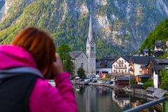 Woman  taking photo of stunning lake and Hallstatt view Stock Photos