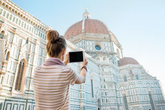 Woman taking photo with tablet pc in florence Royalty Free Stock Images