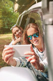Woman taking photo to her friend through the Stock Photo