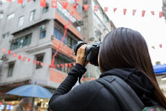 Woman taking photo using camera Royalty Free Stock Photography