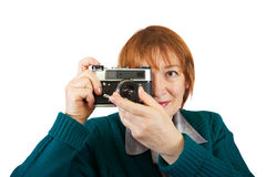 Woman taking photo with vintage camer Stock Image