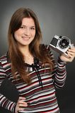 Woman taking photo with vintage camera Stock Images