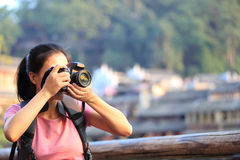Woman taking photo Stock Images