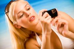 Woman taking photograph Stock Image
