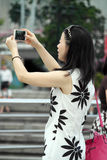 Woman Taking A Photograph Stock Photography