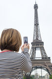 Woman taking photographs of eiffel tower paris Royalty Free Stock Image