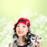 Woman taking photographs with vintage camera Stock Photo