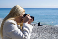 Woman taking photos Royalty Free Stock Images