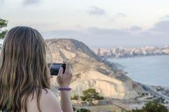 Woman taking photos in Alicante Santa Barbara castle. Royalty Free Stock Photo