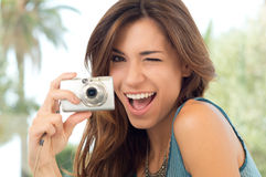 Woman Taking Photos With Camera Stock Images
