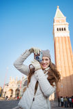 Woman taking photos with camera near Campanile di San Marco Royalty Free Stock Images