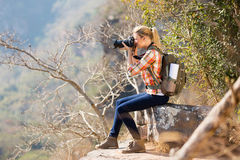 Woman taking photos cliff Royalty Free Stock Images