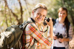Woman taking photos friend. Pretty young women taking photos of her friend in autumn mountain Royalty Free Stock Photography