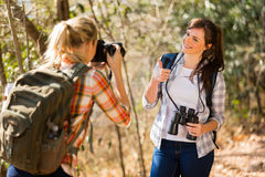 Woman taking photos friend Stock Images