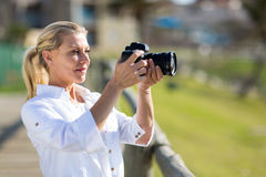 Woman taking photos Royalty Free Stock Photography