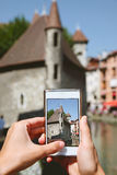 Woman taking photos with mobile phone. Royalty Free Stock Photography