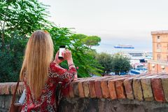 Woman taking photos on mobile phone in Marina Grande Sorrento. Woman taking photos on mobile phone in Marina Grande in Sorrento, Tyrrhenian sea, Amalfi coast Stock Images