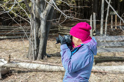 Woman taking photos near Lake Champlain Royalty Free Stock Photography