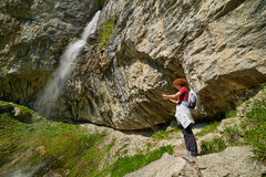 Woman taking photos near the waterfall Stock Images