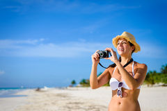 Woman taking photos at tropical caribbean beach Stock Images