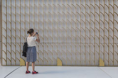 Woman taking a pic at Expo 2015 in Milan, Italy Stock Photo