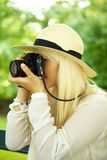 Woman taking a picture Stock Images