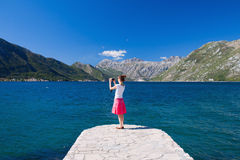 Woman taking picture Stock Photography