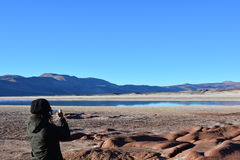 Woman taking a picture of Atacama desert, in Chile Royalty Free Stock Photos
